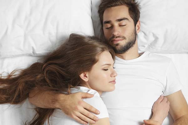 image of a couple someone sleeping